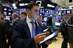 Trader Craig Spector works on the floor of the New York Stock Exchange, Thursday, Feb. 6, 2020. U.S. stocks rose in midday trading Thursday as investors continued focusing on the latest round of corporate earnings and China cut tariffs on key imports as part of a trade war truce. (AP Photo/Richard Drew)