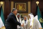 U.S. Secretary of State Mike Pompeo, left, shakes hands with Kuwait's Emir Sheikh Sabah Al-Ahmad Al- Jaber Al-Sabah, in Kuwait City, Kuwait,   Wednesday, March 20, 2019. (Jim Young/Pool Photo via AP)