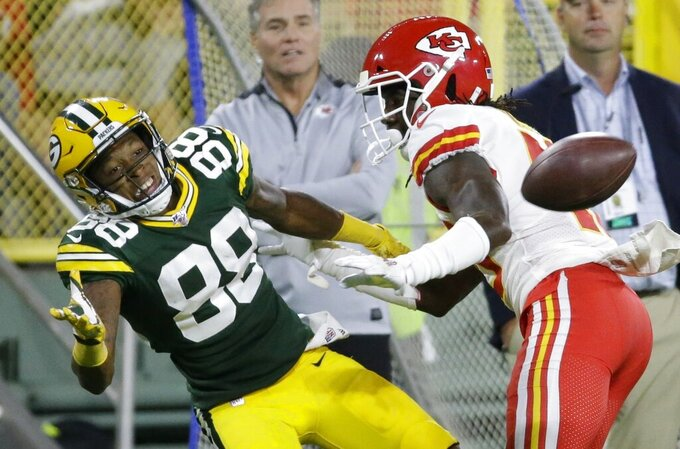 Kansas City Chiefs' D'Montre Wade breaks up a pass intended for Green Bay Packers' Teo Redding during the second half of a preseason NFL football game Thursday, Aug. 29, 2019, in Green Bay, Wis. (AP Photo/Mike Roemer)