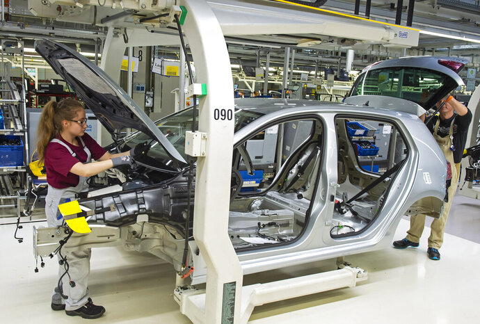 File--- Picture taken May 14, 2019 shows complete Golf car bodies at the assembly line during a press tour of the plant of the German manufacturer Volkswagen AG (VW) in Zwickau, Germany. The first ID. production electrical vehicles are to roll off the assembly line at the end of 2019. Only e-cars will be built at Zwickau in 2021. (AP Photo/Jens Meyer)