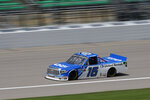 Austin Hill (16) drives a lap during a NASCAR Truck Series auto race at Kansas Speedway in Kansas City, Kan., Saturday, July 25, 2020. (AP Photo/Charlie Riedel)