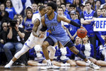 Villanova's Saddiq Bey (41) drives against Seton Hall's Shavar Reynolds, left, during the second half of an NCAA college basketball game Wednesday, March 4, 2020, in Newark, N.J. (AP Photo/John Minchillo)