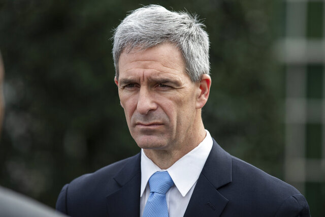 Acting Deputy Secretary for the Department of Homeland Security Ken Cuccinelli speaks about the coronavirus outside the West Wing of the White House, Friday, March 20, 2020, in Washington. (AP Photo/Alex Brandon)