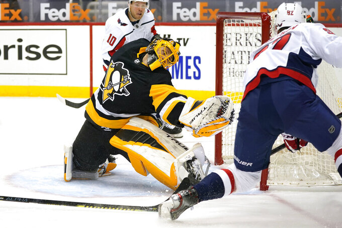 Washington Capitals' Evgeny Kuznetsov (92) scores against Pittsburgh Penguins goaltender Casey DeSmith during the second period of an NHL hockey game in Pittsburgh, Tuesday, Jan. 19, 2021. The Penguins won 5-4 in overtime. (AP Photo/Gene J. Puskar)