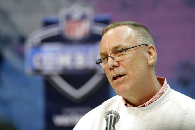 FILE - In this Feb. 28, 2019, file photo, Cleveland Browns general manager John Dorsey speaks during a press conference at the NFL football scouting combine in Indianapolis. Dorsey says he's in no rush to trade running back Duke Johnson, who has asked to be moved. During his pre-draft news conference Wednesday, April 17, 2019, Dorsey said Johnson has not reported for the Browns' voluntary offseason workout program, which began on April 1.(AP Photo/Darron Cummings, File)