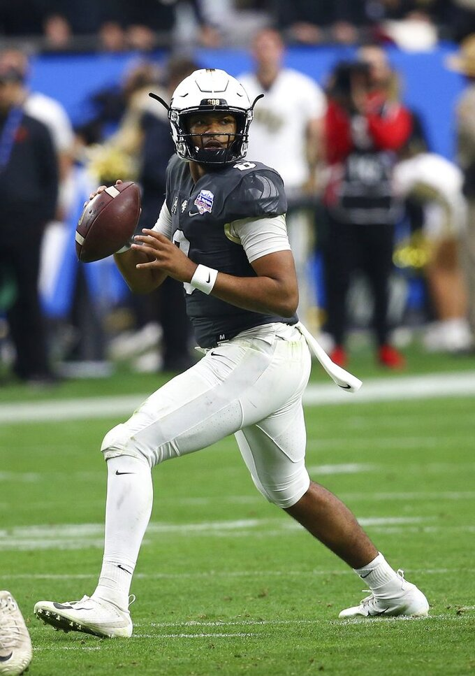 UCF quarterback Darriel Mack Jr. (8) looks to throw the ball against LSU during the first half of the Fiesta Bowl NCAA college football game Tuesday, Jan. 1, 2019, in Glendale, Ariz. (AP Photo/Ross D. Franklin)