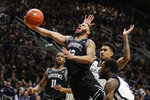 Providence guard Luwane Pipkins (12) is fouled as he shoots by Butler forward Jordan Tucker (1) and guard Kamar Baldwin (3) in the second half of an NCAA college basketball game in Indianapolis, Saturday, Feb. 1, 2020. Providence defeated Butler 65-61. (AP Photo/Michael Conroy)