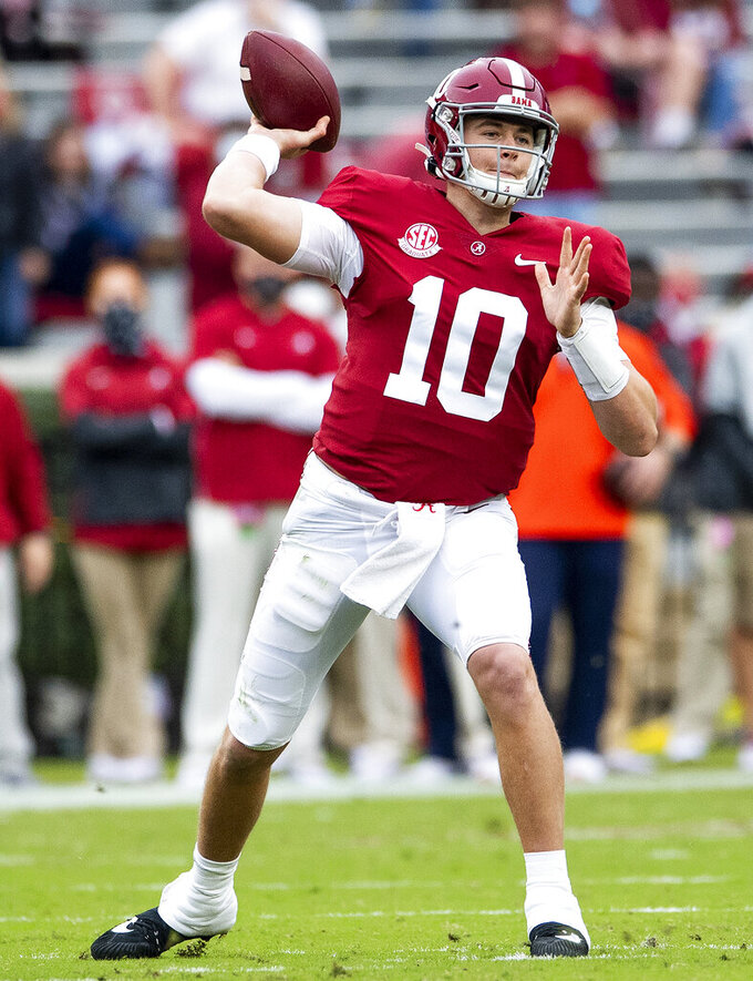 Alabama quarterback Mac Jones (10) throws a pass against Auburn during an NCAA college football game Saturday, Nov. 28, 2020, in Tuscaloosa, Ala. (Mickey Welsh/The Montgomery Advertiser via AP)