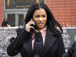 Joycelyn Savage, one of R&B singer R. Kelly's girlfriends, walks out of the Cook County Domestic Violence Courthouse, Thursday morning, Jan. 23, 2020, in Chicago. Savage pleaded not guilty to a misdemeanor battery charge for allegedly punching another of the the R&B singer's girlfriends in the face. (Ashlee Rezin Garcia/Chicago Sun-Times via AP)