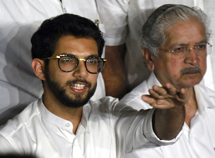 Shiv Sena leader Aditya Thackeray speaks to the media at the Maharashtra state Governor's residence in Mumbai, India, Monday, Nov. 11, 2019. Indian Prime Minister Narendra Modi's governing party has suffered a big setback in western Maharashtra state after its longtime ally Shiv Sena broke away and joined two other parties to form the new state government. (AP Photo/Rajanish Kakade)