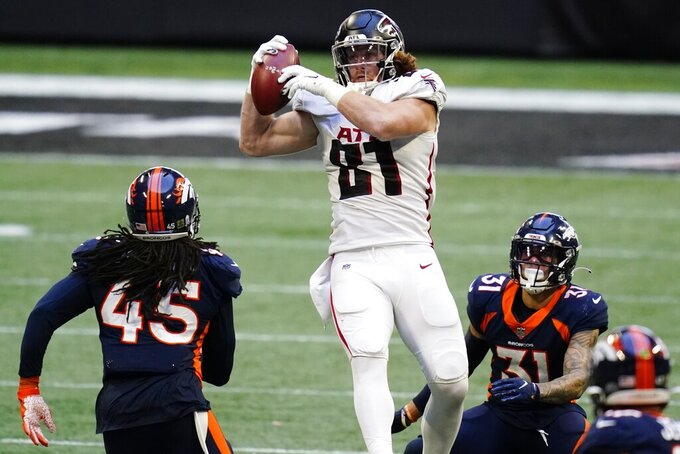 Atlanta Falcons tight end Hayden Hurst (81) makes the catch against the Denver Broncos during the second half of an NFL football game, Sunday, Nov. 8, 2020, in Atlanta. (AP Photo/Brynn Anderson)