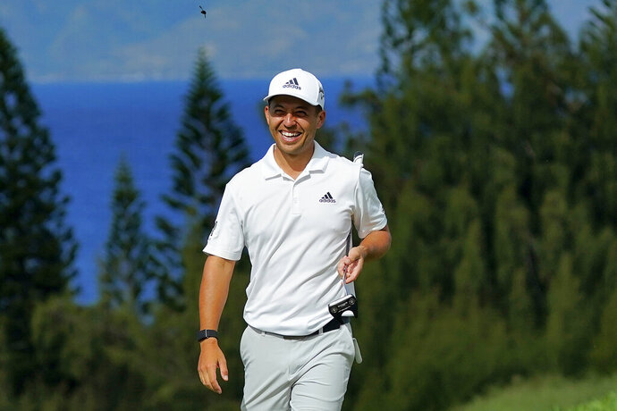 Defending Champion Xander Schauffele smiles during the Tournament of Champions pro-am golf event, Wednesday, Jan. 1, 2020, at Kapalua Plantation Course in Kapalua, Hawaii. (AP Photo/Matt York)