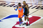 Houston Rockets' P.J. Tucker, right, confronts Oklahoma City Thunder's Dennis Schroder (17) after a foul during the second half of an NBA basketball first round playoff game Saturday, Aug. 29, 2020, in Lake Buena Vista, Fla. Both players were ejected. (AP Photo/Ashley Landis)