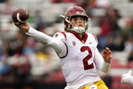 Southern California quarterback Jaxson Dart throws a pass during the second half of an NCAA college football game against Washington State, Saturday, Sept. 18, 2021, in Pullman, Wash. Southern California won 45-14. (AP Photo/Young Kwak)