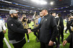 Detroit Lions head coach Matt Patricia, left, greets Minnesota Vikings head coach Mike Zimmer after an NFL football game, Sunday, Dec. 8, 2019, in Minneapolis. The Vikings won 20-7. (AP Photo/Bruce Kluckhohn)