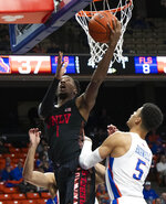 UNLV guard Kris Clyburn drives and scores while defended by Boise State's Malek Harwell during the first half of an NCAA college basketball game Wednesday, Feb. 6, 2019, in Boise, Idaho. (Darin Oswald/Idaho Statesman via AP)