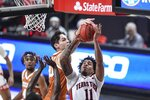 Texas Tech's Kyler Edwards (11) is fouled by Texas' Brock Cunningham (30) during the first half of an NCAA college basketball game in Lubbock, Texas, Saturday, Feb. 27, 2021. (AP Photo/Justin Rex)