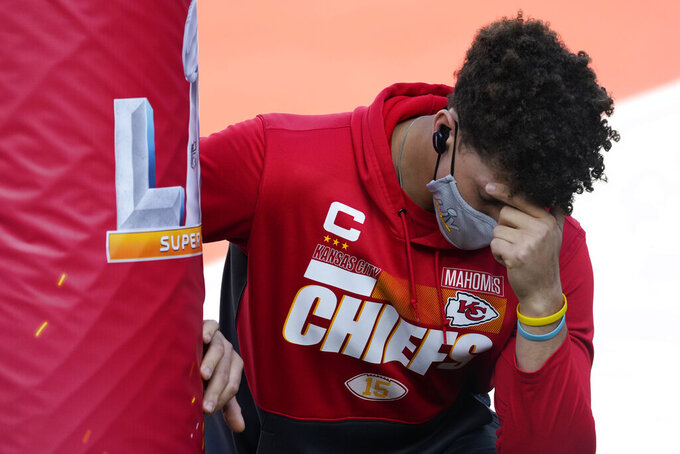 Kansas City Chiefs quarterback Patrick Mahomes kneels next to the goal post before the NFL Super Bowl 55 football game against the Tampa Bay Buccaneers, Sunday, Feb. 7, 2021, in Tampa, Fla. (AP Photo/Chris O'Meara)