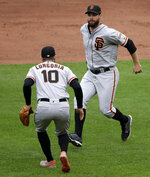 San Francisco Giants' Evan Longoria (10) and Brandon Belt celebrate getting the final out of the ninth inning to preserve a 3-2 win over the Pittsburgh Pirates in a baseball game in Pittsburgh, Sunday, April 21, 2019. (AP Photo/Gene J. Puskar)