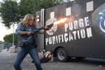 """This image released by Universal Pictures shows Leven Rambin in a scene from """"The Forever Purge,"""" directed by Everardo Valerio Gout. (Jake Giles Netter/Universal Pictures via AP)"""
