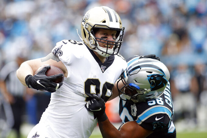 New Orleans Saints tight end Josh Hill (89) is tackled by Carolina Panthers linebacker Jermaine Carter (56) during the first half of an NFL football game in Charlotte, N.C., Sunday, Dec. 29, 2019. (AP Photo/Brian Blanco)