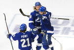 Tampa Bay Lightning defenseman Mikhail Sergachev (98) celebrates his goal against the Dallas Stars with teammates Erik Cernak (81) and Brayden Point (21) during the third period of Game 5 of the NHL hockey Stanley Cup Final, Saturday, Sept. 26, 2020, in Edmonton, Alberta. (Jason Franson/The Canadian Press via AP)
