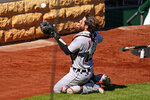 Detroit Tigers catcher Eric Haase makes a sliding catch on a foul ball hit by Pittsburgh Pirates' Kevin Newman during the seventh inning of a baseball game in Pittsburgh, Monday, Sept. 6, 2021. (AP Photo/Gene J. Puskar)