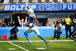 Los Angeles Chargers wide receiver Mike Williams celebrates as he runs for a touchdown during the first half of an NFL football game against the Cleveland Browns Sunday, Oct. 10, 2021, in Inglewood, Calif. (AP Photo/Gregory Bull)