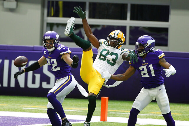 Minnesota Vikings free safety Harrison Smith (22) and cornerback Mike Hughes (21) break up a pass intended for Green Bay Packers wide receiver Marquez Valdes-Scantling (83) during the first half of an NFL football game, Sunday, Sept. 13, 2020, in Minneapolis. (AP Photo/Bruce Kluckhohn)