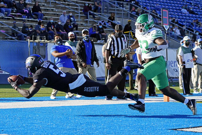 Middle Tennessee running back Chaton Mobley (5) catches a touchdown pass ahead of North Texas linebacker KD Davis (23) in the first half of an NCAA college football game, Saturday, Oct. 17, 2020, in Murfreesboro, Tenn. (AP Photo/Mark Humphrey)