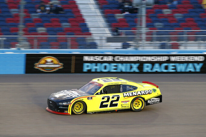 Austin Cindric races through Turn 4 during the NASCAR Xfinity Series auto race at Phoenix Raceway, Saturday, Nov. 7, 2020, in Avondale, Ariz. (AP Photo/Ralph Freso)