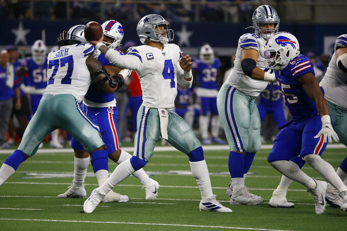 Dallas Cowboys quarterback Dak Prescott (4) throws a pass under pressure from Buffalo Bills defensive end Jerry Hughes (55) in the second half of an NFL football game in Arlington, Texas, Thursday, Nov. 28, 2019. (AP Photo/Ron Jenkins)