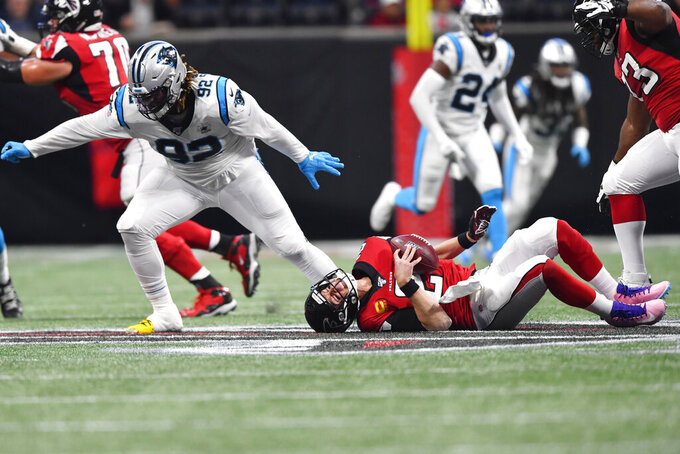 Carolina Panthers defensive tackle Stacy McGee (92) sacks Atlanta Falcons quarterback Matt Ryan (2) during the first half of an NFL football game, Sunday, Dec. 8, 2019, in Atlanta. (AP Photo/John Amis)