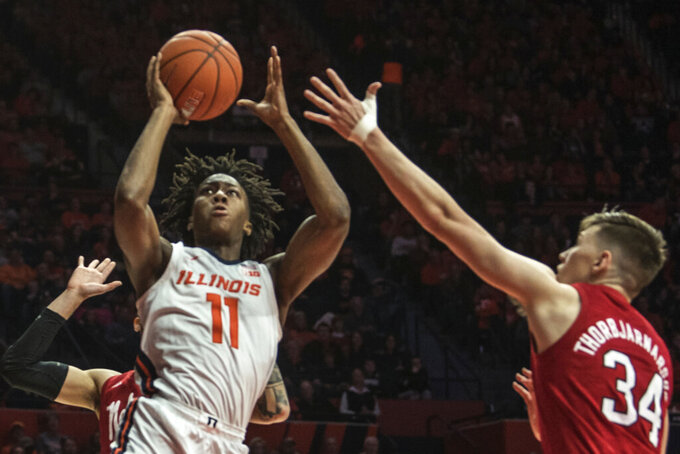 Illinois' Ayo Dosunmu (11) shoots as Nebraska's Thorir Thorbjarnarson (34) defends in the first half of an NCAA college basketball game Monday, Feb. 24, 2020, in Champaign, Ill. (AP Photo/Holly Hart)