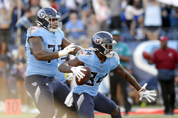 Tennessee Titans wide receiver Corey Davis (84) celebrates after scoring a touchdown against the Los Angeles Chargers in the first half of an NFL football game Sunday, Oct. 20, 2019, in Nashville, Tenn. (AP Photo/Mark Zaleski)