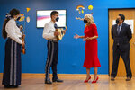 From left, Luis Marquez, 17, Suesan Jarquin, 17, and Edwin Perez, 17, all with Chicago Mariachi Program speak with first lady Jill Biden during a visit and tour of the National Museum of Mexican Art in Pilsen, Ill. Tuesday, Oct. 12, 2021. (Tyler LaRiviere/Chicago Sun-Times via AP)