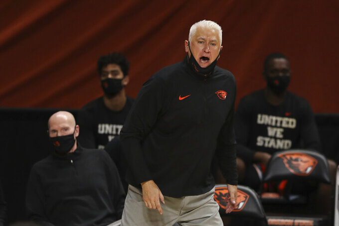 Oregon State head coach Wayne Tinkle calls instructions to players during the second half of an NCAA college basketball game against Oregon in Corvallis, Ore., Sunday, March 7, 2021. (AP Photo/Amanda Loman)