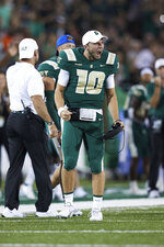 Charlotte quarterback Riley Leonard (10) reacts after a touchdown during the team's NCAA college football game against Duke on Friday, Sept. 3, 2021, in Charlotte, N.C. (AP Photo/Brian Westerholt)