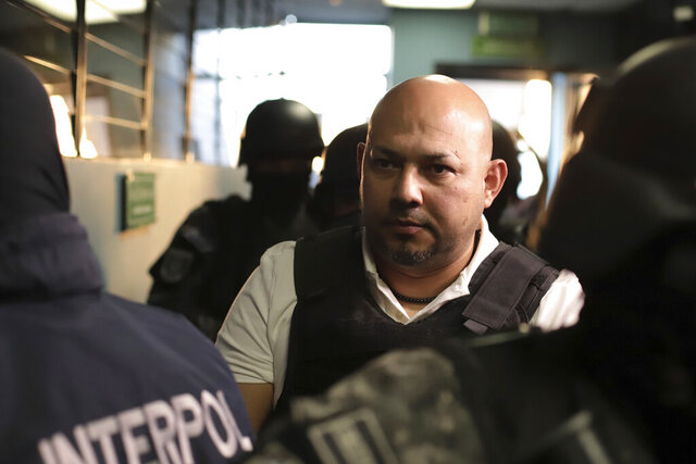 former Salvadoran congressman Roberto Silva Pereira arrives at the Judicial Center of San Salvador, El Salvador, Wednesday, Jan. 8, 2020. Silva Pereira who was a congressman from El Salvador's conservative National Conciliation Party was arrested Wednesday following his deportation from the United States, where he fled in 2007. He allegedly bribed local officials to grant unfair contracts to front companies. (AP Photo/Salvador Melendez)
