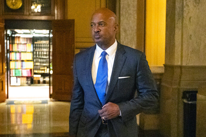 FILE - In this Oct. 23, 2019, file photo, Indiana Attorney General Curtis Hill arrives for a hearing at the state Supreme Court at the Statehouse in Indianapolis. Hill's law license will be suspended for 30 days over an allegation that he drunkenly groped four women during a party, the state Supreme Court ruled Monday, May 11, 2020. The unanimous court decision said that the state's attorney disciplinary commission