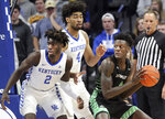 Utah Valley's Emmanuel Olojakpoke, right, looks for an opening on Kentucky's Kahlil Whitney (2) and Nick Richards (4) during the first half of an NCAA college basketball game in Lexington, Ky., Monday, Nov. 18, 2019. (AP Photo/James Crisp)