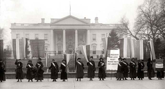 "This undated image released by PBS shows Suffragists picketing outside the White House, used in ""The Vote,"" a two-part, four-hour PBS documentary marking the 100th anniversary of the 19th Amendment that gave women the vote. The documentary airs Monday and Tuesday on PBS' ""American Experience."" (PBS via AP)"