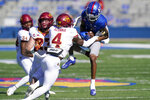 Kansas wide receiver Andrew Parchment (4) catches a pass while covered by Iowa State linebacker Mike Rose (23) and defensive back Arnold Azunna (4) during the first half of an NCAA college football game in Lawrence, Kan., Saturday, Oct. 31, 2020. (AP Photo/Orlin Wagner)