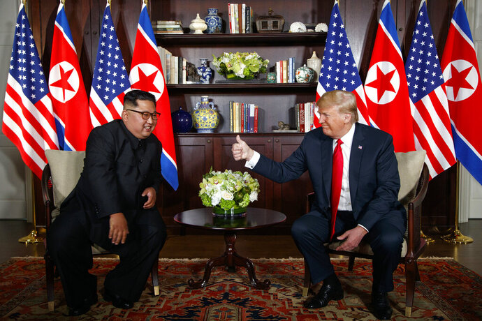 FILE - In this June 12, 2018 file photo, President Donald Trump meets with North Korean leader Kim Jong Un on Sentosa Island, Tuesday, June 12, 2018, in Singapore.  With their second summit fast approaching, speculation is growing that Trump may try to persuade Kim to commit to denuclearization by giving him something he wants more than almost anything else, an announcement of peace and an end to the Korean War.(AP Photo/Evan Vucci)