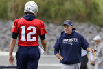 New England Patriots quarterback Tom Brady (12) and head coach Bill Belichick, right, speak during an NFL football practice, Wednesday, Sept. 18, 2019, in Foxborough, Mass. (AP Photo/Steven Senne)