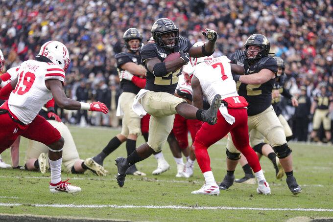 Purdue running back King Doerue (22) leaps in for a touchdown against Nebraska during the second half of an NCAA college football game in West Lafayette, Ind., Saturday, Nov. 2, 2019. Purdue defeated Nebraska 31-27. (AP Photo/Michael Conroy)