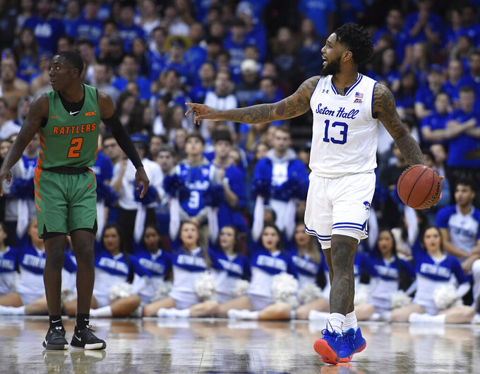 CORRECTS DATE - Seton Hall guard Myles Powell (13) slows down the offense as Florida A&M guard Kamron Reaves (2) defends during the first half of an NCAA college basketball game, Saturday, Nov. 23, 2019, in Newark, N.J. (AP Photo/Sarah Stier)