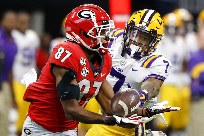 Georgia wide receiver Tyler Simmons (87) cannot pull in a pass against the defense of LSU safety Grant Delpit (7) during an NCAA college football game for the Southeastern Conference championship Saturday, Dec. 7, 2019, in Atlanta. (C.B. Schmelter/Chattanooga Times Free Press via AP)