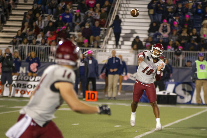 New Mexico State quarterback Jonah Johnson (10) throws to wide receiver Cole Harrity (14) during the first half against Nevada in an NCAA college football game in Reno, Nev., Saturday, Oct. 9, 2021. (AP Photo/Tom R. Smedes)
