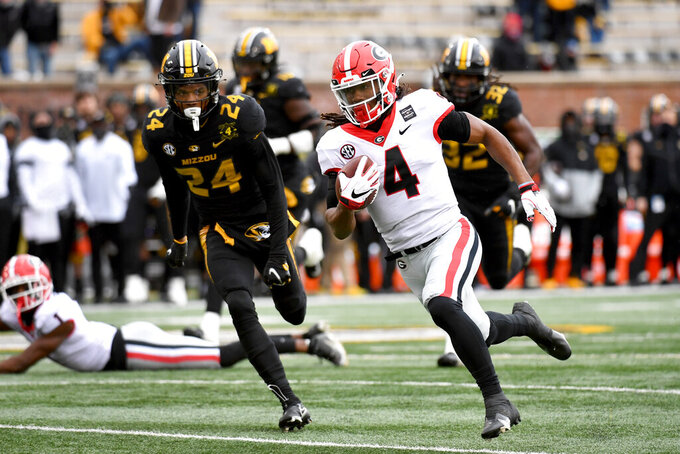 Georgia running back James Cook (4) runs past Missouri defensive back Ishmael Burdine (24) on his way to a touchdown during the first half of an NCAA college football game Saturday, Dec. 12, 2020, in Columbia, Mo. (AP Photo/L.G. Patterson)